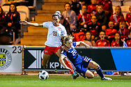 Erin Cuthbert (#22) of Scotland slips while contesting the ball with Eseosa Aigbogun (#19) of Switzerland during the 2019 FIFA Women's World Cup UEFA Qualifier match between Scotland Women and Switzerland at the Simple Digital Arena, St Mirren, Scotland on 30 August 2018.