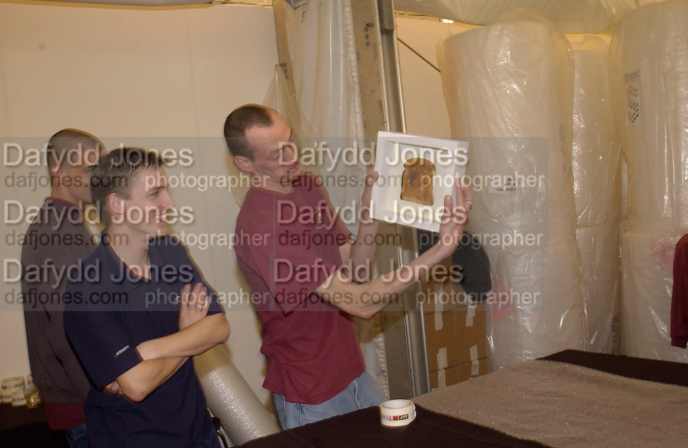 Wrapping the framed Elvis toast sold by the Hossack gallery for £95. The Affordable Art Fair private view ( in aid of Barnados) Battersea. 19 March 2003. © Copyright Photograph by Dafydd Jones 66 Stockwell Park Rd. London SW9 0DA Tel 020 7733 0108 www.dafjones.com