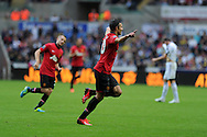 Robin Van Persie of Man Utd celebrates after he scores his sides 3rd goal (his 2nd). Barclays Premier league, Swansea city v Manchester Utd in Swansea, South Wales on Saturday 17th August 2013. pic by Andrew Orchard ,Andrew Orchard sports photography,