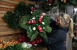 Alice Graham makes Christmas wreaths at the Smiddy Farm Shop near Doune, Stirling.