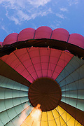 Vertical of hot air balloon being inflated<br />