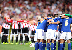 Ipswich Town and Brentford players huddle before kick off - Mandatory by-line: Robbie Stephenson/JMP - 07966386802 - 08/08/2015 - SPORT - FOOTBALL - Brentford,England - Griffin Park - Brentford v Ipswich Town - Sky-Bet Championship