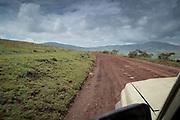 View from a 4x4 safari car driving along a dirt road, Ngorongoro Conservation area, Tanzania