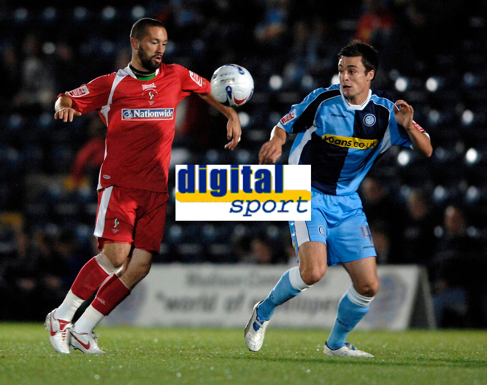 Photo: Richard Lane.<br />Wycombe Wanderers v Swindon Town. Coca Cola League 2. 26/09/2006. <br />Swindon's Christian Roberts is challenged by Wycombe's Russell Martin.