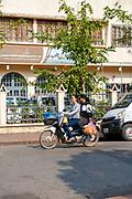 Morning traffic at the intersection of Kitsalat Road and Chaofa Ngum Road, Luang Prabang, Laos.