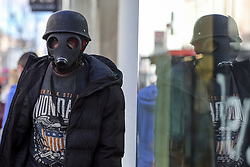 © Licensed to London News Pictures. 11/03/2020. London, UK. A shopper on London's Oxford Street wearing a gas mask amid an increased number of cases of Coronavirus (COVID-19) in the UK. Chancellor RISHI SUNAK has unveiled a £30bn package to help the economy get through the coronavirus outbreak in the UK. Photo credit: Dinendra Haria/LNP