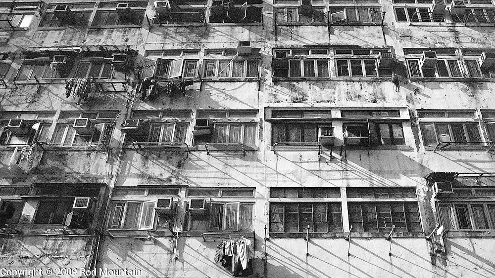 The exterior view of an older apartment building in Hong Kong. © Rod Mountain