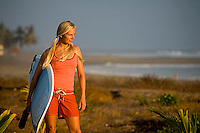 Young woman going surfing in Mexico.