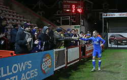 Joe Ward of Peterborough United high-fives the traveling supporters at full-time - Mandatory by-line: Joe Dent/JMP - 04/12/2018 - FOOTBALL - St James Park - Exeter, England - Exeter City v Peterborough United - Checkatrade Trophy