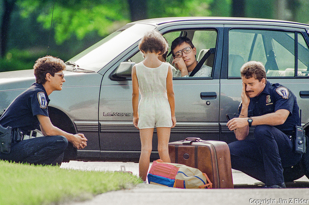 A young girl negotiates with her parents and Troy, Michigan police after running away from home.  Her parents followed her through their apartment complex to see how far she would go but had to bring the adventure to an end when she approached a busy four-lane road.  Neighbors became suspicious and called police when the standoff between the girl and her parents lasted nearly an hour.  The girl was convinced to return home.