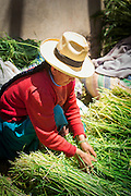 Quechua woman selling produce at Chinchero Town Sunday Market, Cusco Region, Peru, South America