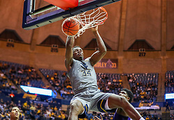Jan 14, 2020; Morgantown, West Virginia, USA; West Virginia Mountaineers forward Oscar Tshiebwe (34) dunks the ball during the second half against the TCU Horned Frogs at WVU Coliseum. Mandatory Credit: Ben Queen-USA TODAY Sports