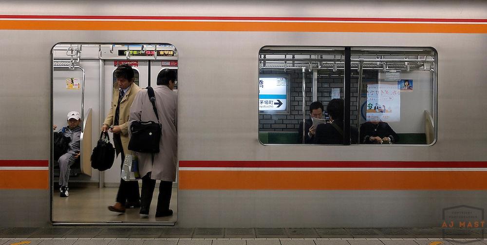 Train Commuters in Tokyo Japan Friday, Nov. 22, 2011.