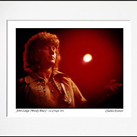 """John Lodge - An affordable archival quality matted print ready for framing at home.<br />  Ideal as a gift or for collectors to cherish, printed on Fuji Crystal Archive photographic paper set in a neutral mat (all mounting materials are acid free conservation grade). <br />  The image (approx 6""""x8"""") sits within a titled border. The outer dimensions of the mat are approx 10""""x12"""""""