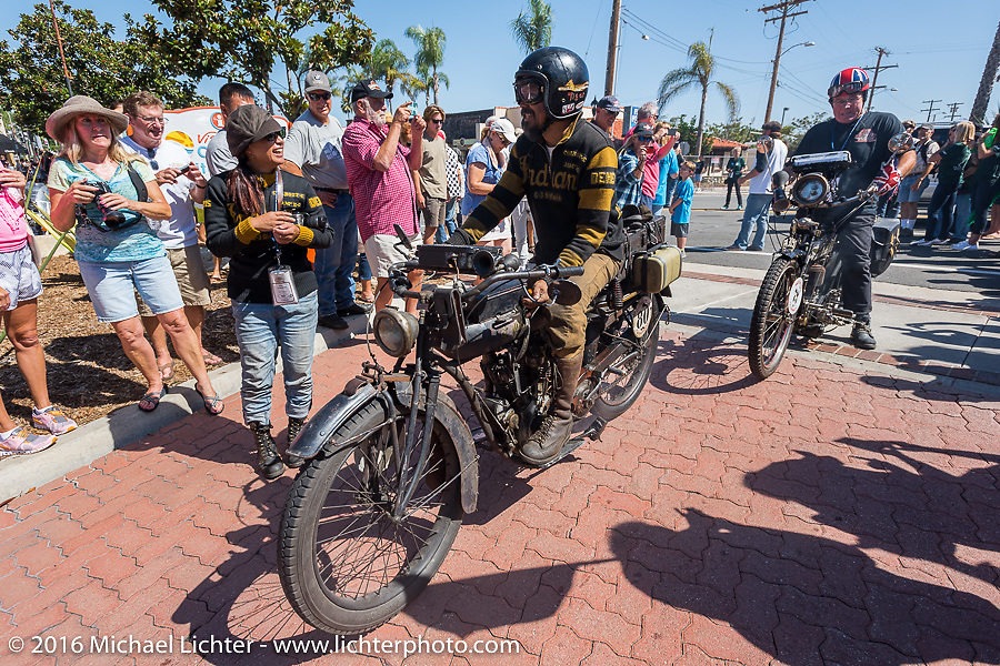 Shinya Kimura rides over the finish in Carlsbad, CA on his Team-80 1915 Indian twin during the Motorcycle Cannonball Race of the Century. Stage-15 ride from Palm Desert, CA to Carlsbad, CA. USA. Sunday September 25, 2016. Photography ©2016 Michael Lichter.