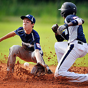 Beaufort infielder Jacob Horton, left, misses the catch while attempting to tag Hilton Head Island runner Cameron Bent, right, during the Dixie Boys District 8 baseball tournament at Burton Wells Park on July 3, 2014.