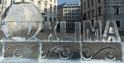 """03.11.2015, Ballhausplatz, Wien, AUT, WWF Protestaktion zum Klimaschutz vor dem Bundeskanzleramt. im Bild Eisskulptur Erdkugel und Schriftzug Klima // ice sculpture """"Earth and climate"""" during protest action of the World Wildlife Fund (WWF) according to climate change in front of the austrian federal chancelly in Vienna, Austria on 2015/11/03 EXPA Pictures © 2015, PhotoCredit: EXPA/ Michael Gruber"""