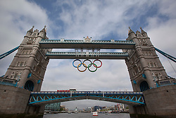© licensed to London News Pictures. London, UK 27/06/2012. Giant Olympic rings, which are displayed from Tower Bridge, unveiled today. Photo credit: Tolga Akmen/LNP