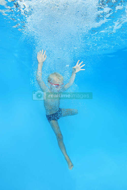 September 18, 2016 - Odessa, Ukraine - 5 years boy in a swimming goggles jumping into swimming pool (Credit Image: © Andrey Nekrasov/ZUMA Wire/ZUMAPRESS.com)