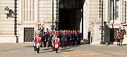 Marching soldiers in traditional dress uniform, Palacio Real royal palace, Madrid, Spain