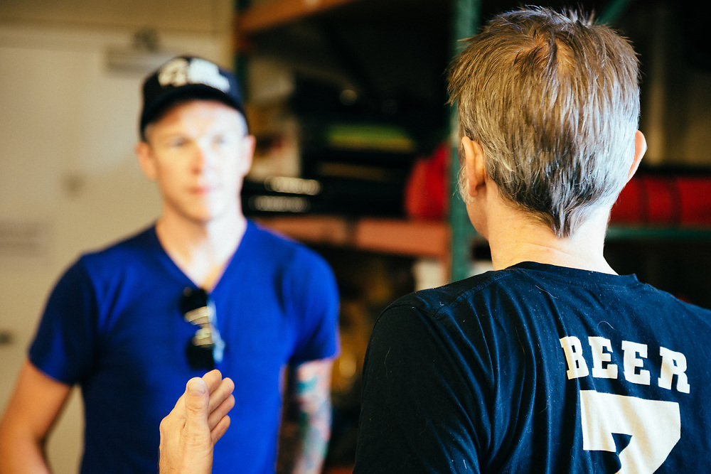 Scott Turner talks with an employee regarding the upcoming Downeville Classic.