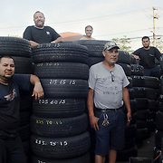 Hugo Lopez from El Salvador, Jose Maldonado from Puerto Rico, Esteban Rivera from Puerto Rico, Anibal Gonzalez from Puerto Rico and owner of the business and Darwin Morillo from El Salvador pose for a portrait at their workspace New Car City Auto Repair located in Brentwood. (July. 12, 2012)