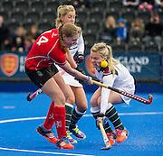 Surbiton's Hollie Webb deflects Lizzie Neal's shot into her cheek. Canterbury v Surbiton - Investec Women's Hockey League Championship Final, Lee Valley Hockey & Tennis Centre, London, UK on 19 April 2015. Photo: Simon Parker
