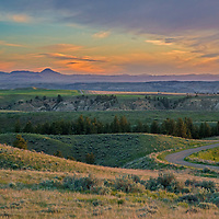 A sunrise glows over the Bears Paw Mountains and the Upper Missouri River Breaks in Montana.