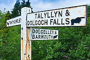 Signpost to Dolgelley, Barmouth, Talyllyn and Dolgoch Falls in Snowdonia, Gwynedd, Wales