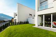 modern house white, view from the garden