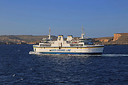 Gozo Channel Line ferry ship passing island of Comino on crossing to Gozo from Malta
