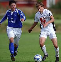 Fotball 2. divisjon 27.08.05 - Ranheim - Mo 4-2<br /> Robert Vestad, Ranheim, Catro Jørgensen, Mo<br /> Foto: Carl-Erik Eriksson, Digitalsport