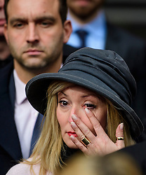 © Licensed to London News Pictures. 28/02/2017. London, UK. Manda Churchill, A relative of one of the victims of the Tunisia terror attack wipes a tear from her eye while leaving the Royal Courts of Justice in London where Judge Nicholas Loraine-Smith handed down a ruling on the cause of death of 30 Britons gunned down by Seifeddine Rezgui, on a beach in Sousse, Tunisia.  Photo credit: Ben Cawthra/LNP
