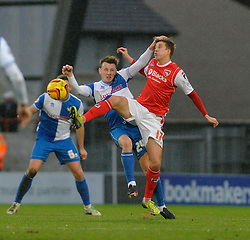 Bristol Rovers' Ollie Clarke challenges Morecambe's Andrew Fleming - Photo mandatory by-line: Dougie Allward/JMP - Tel: Mobile: 07966 386802 14/12/2013 - SPORT - Football - Morecombe - Globe Arena - Morecombe v Bristol Rovers - Sky Bet League Two