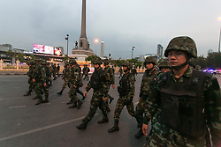 © Licensed to London News Pictures. 26/05/2014. Thai soldiers form of line in front of victory monument following a Anti-Coup protest in Bangkok Thailand. Today Thailand's King formally approved Thai army chief General Prayut Chan-O-Cha as head of the nation's new military junta.  Photo credit : Asanka Brendon Ratnayake/LNP