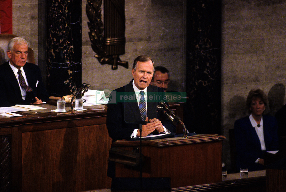 United States President George H.W. Bush speaks to a Joint Session of the U.S. Congress on the situation with Iraq and the Persian Gulf and on the federal deficit in the U.S. Capitol in Washington, D.C. on September 11, 1990. Looking on from left is the Speaker of the US House of Representatives Tom Foley (Democrat of Washington). Photo by Ron Sachs / CNP /ABACAPRESS.COM