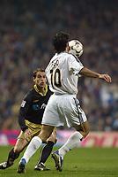 7/2/2004 Madrid, Spain.<br />La Liga (Spanish League) stage 23<br />R.Madrid 2 - Malaga 1<br />R.Madrid's Figo in duel with Malaga's Duda at Santiago Bernabeu's Stadium.<br />© 2004 Alejandro leon Fernandez