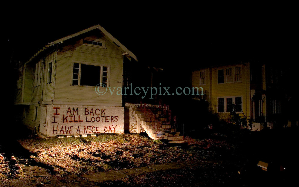 21 December 05. New Orleans, Louisiana.  Post Katrina aftermath. <br /> Graffiti lingers on the walls of the devastated Fontain Bleau neighbourhood long after the devastating flood from Hurricane Katrina subsided. <br /> Photo; ©Charlie Varley/varleypix.com