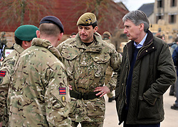 © Licensed to London News Pictures. 09/03/2012. Copedown Hill, UK. Secretary of Defence Philip Hammond (dark clothing) visits troops who are being deployed to Afghanistan next month. The 12thMechanized Brigade (12 Mech Bde) at Copehill Down, Salisbury Plain Training Area, Wiltshire,on FRIDAY 09 MARCH 2012, as it prepares to deploy to Helmand Province, Afghanistan, on Operation Herrick 16, in the Spring of this year. The Brigade were performing a dynamic demonstration of combined Afghan/ISAF operations supported by surveillance assets and casualty evacuation capability. Tornado GR4 fast jest ground support was also displayed.. Photo credit : Stephen SImpson/LNP