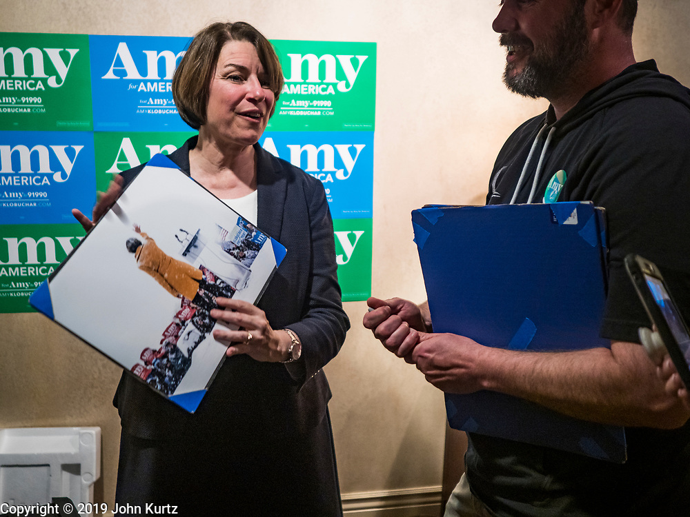 25 MAY 2019 - IOWA FALLS, IOWA: US Senator AMY KLOBUCHAR (D-MN), holds a copy of her taken at her presidential campaign launch during a blizzard on February 9 in Minneapolis. The photo was given to her by a person who attended her campaign event in Iowa Falls Saturday. Sen. Klobuchar is touring Iowa this weekend to support her bid to be the Democratic nominee in 2020 for the US Presidency. Iowa traditionally hosts the the first election event of the presidential election cycle. The Iowa Caucuses will be on Feb. 3, 2020.         PHOTO BY JACK KURTZ