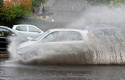 ©Licensed to London News Pictures 21/10/2020  <br /> Aylesford, UK. Wet driving conditions and a flooded A20 London road at Aylesford in Kent near Maidstone. The Met office has issued a severe weather warning for the UK as storm Barbara comes in from Spain bringing winds and torrential rain. Photo credit:Grant Falvey/LNP