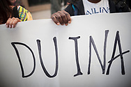 """A volunteer and an Africant migrat hold a banner that reads """"Dignified"""" during a demonstration asking for a dignified and Integral hosting for migratns in transit. Irun (Basque Country). October 10, 2018. A group of volunteers have created a hosting network for migrants in transit who have already completed the 5-day period that can remain in public resources. This group of volunteers is avoiding a serious humanitarian problem Irún, the Basque municipality on the border with Hendaye. As the number of migrants arriving on the coasts of southern Spain incresead, more and more migrants are heading north to the border city of Irun. (Gari Garaialde / Bostok Photo)."""
