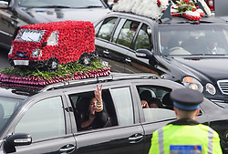 © Licensed to London News Pictures. 03/05/2018. St Mary Cray, UK. People gesture from a car window as The funeral of burglar Henry Vincent in St Mary Cray, Bromley, London. Henry Vincent, who is part of a traveller community in the south east London, died during an attempted burglary of the home of pensioner Richard Osborn-Brook in Hither Green. Photo credit: Ben Cawthra/LNP