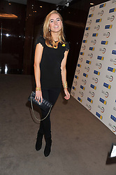 KIMBERLY GARNER at the launch of Samsung's NX Smart Camera at charity auction with David Bailey in aid of Marie Curie Cancer Care at the Bulgari Hotel, 171 Knightsbridge, London on 14th May 2013.