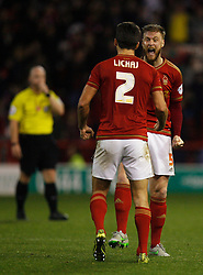 Eric Lichaj (L) and Matthew Mills of Nottingham Forest celebrate at the final whistle - Mandatory byline: Jack Phillips / JMP - 07966386802 - 6/11/2015 - FOOTBALL - The City Ground - Nottingham, Nottinghamshire - Nottingham Forest v Derby County - Sky Bet Championship