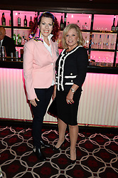 Left to right, CLEO ROCOS and ELAINE PAIGE at a party to celebrate the publication of 'Passion for Life' by Joan Collins held at No41 The Westbury Hotel, Mayfair, London on21st October 2013.
