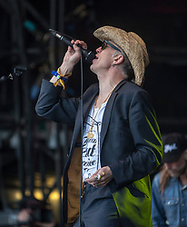 "Rob Spragg of Alabama 3 play the main stage. Sunday, Rockness 2013, the annual music festival which took place in Scotland at Clune Farm, Dores, on the banks of Loch Ness, near Inverness in the Scottish Highlands. The festival is known as ""the most beautiful festival in the world""."