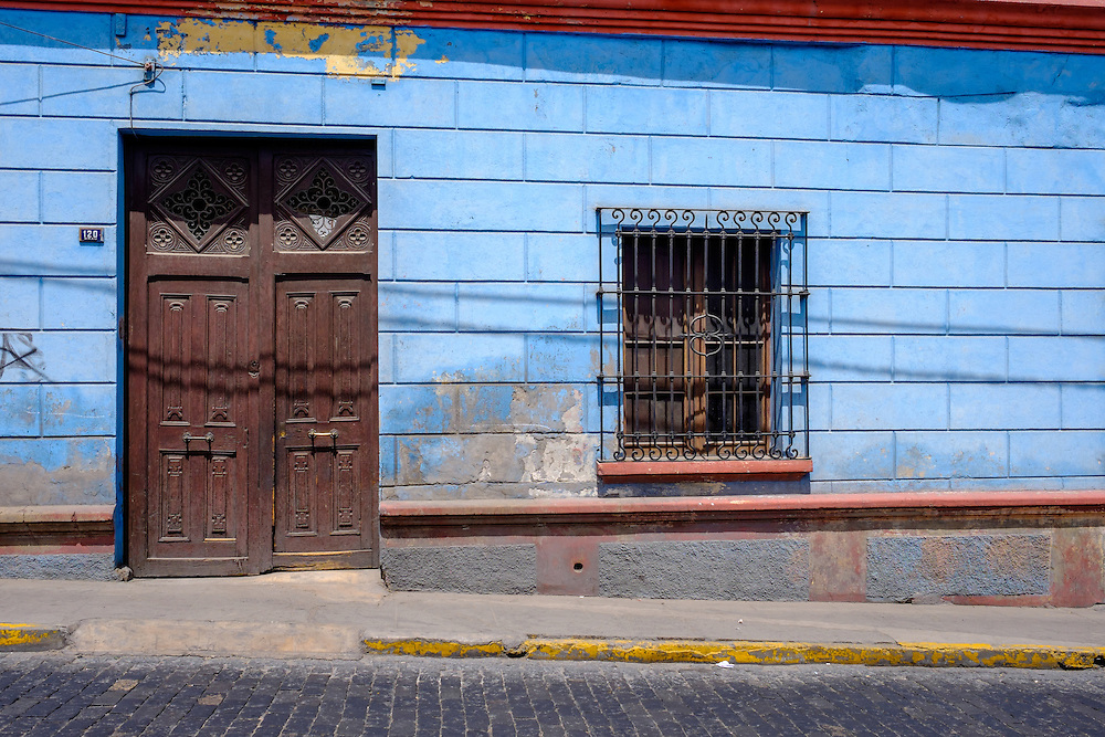 AREQUIPA, PERU - CIRCA APRIL 2014: Typical facade of Arequipa. Arequipa is the Second city of Perú by population with 861,145 inhabitants and is the second most industrialized and commercial city of Peru.