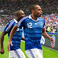 05 September 2009: French forward and captain Thierry Henry and French defender William Gallas celebrate with the crowd after scoring during the World Cup 2010 qualifying football match France vs. Romania (1-1), on September 5, 2009 at the Stade de France stadium in Saint-Denis, near Paris, France.