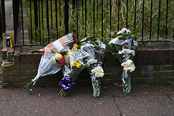 ©Licensed to London News Pictures; 10/09/2021, London UK;Flowers are left at a police cordon as Met Detectives launch a murder investigation in Newham, East London after a male in his thirties was pronounced dead at a property in Ringlet Close, Canning Town. Emergency services were called at 03.40 this morning to reports of a male suffering from stab wounds and are questioning a 43 year old female arrested at the scene  : Photo credit, Steve Poston/LNP